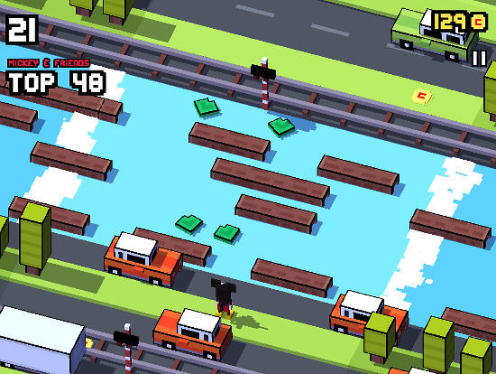 Guide Mickey across the river by stepping on the floating logs and lilly pads in Disney Crossy Road
